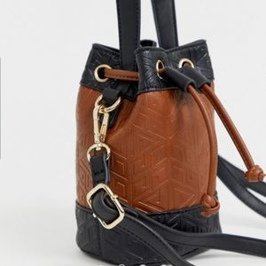Mini Bucket Bag in Embossed Monogram